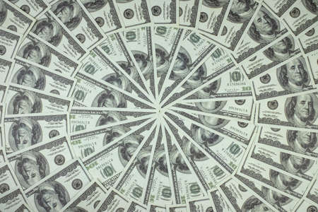 Photo pour Group of money stack of 100 US dollars banknotes a lot of is arranged in a beautiful circle - image libre de droit