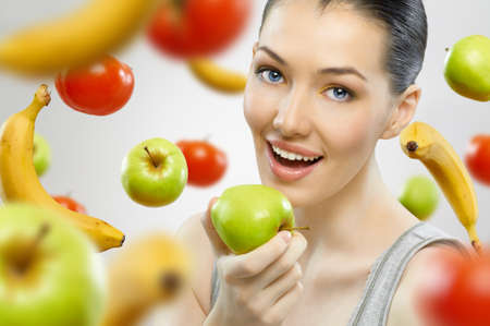 A beautiful slender girl eating healthy fruit