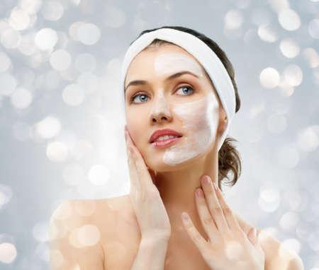 beauty women getting facial mask