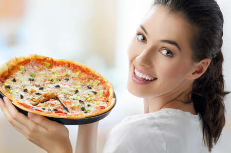 Girl eating a delicious pizza