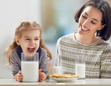 girl drinking milk at the kitchen