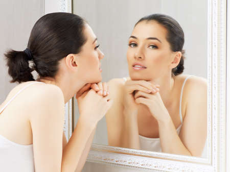 a beauty girl on the mirror background