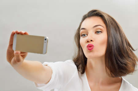 a beauty girl taking selfieの写真素材