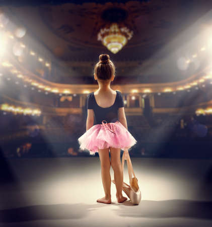 little girl plays in the ballet