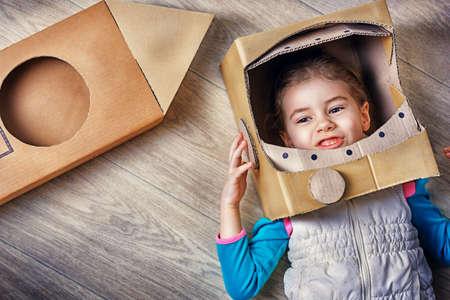 Photo pour child is dressed in an astronaut costume - image libre de droit