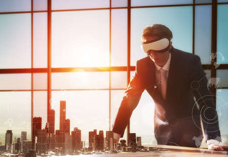 Foto de businessman developing a project using virtual reality goggles. the concept of technologies of the future - Imagen libre de derechos