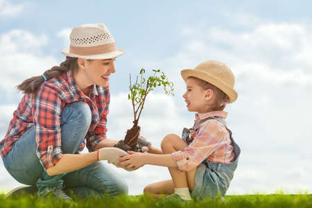 Photo for Mom and her child girl plant sapling tree. Spring concept, nature and care. - Royalty Free Image