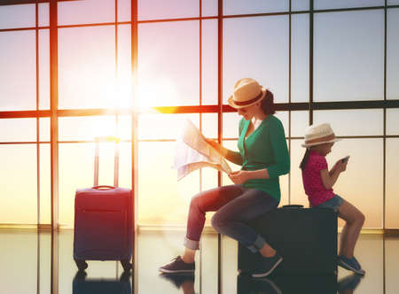 Photo for Happy family with suitcases in the airport. - Royalty Free Image