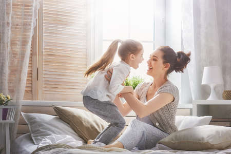 Photo pour Happy loving family. Mother and her daughter child girl playing and hugging. - image libre de droit
