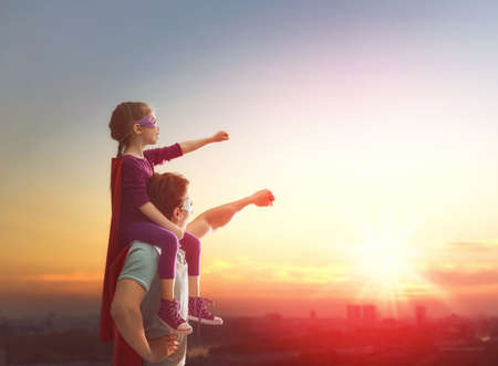 Photo for Happy loving family. Father and his daughter child girl playing outdoors. Daddy and her child girl in an Superhero's costumes. Concept of Father's day. - Royalty Free Image