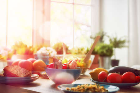 Foto de balanced diet, cooking, culinary and food concept. food for a family dinner on a wooden table in the dining room. - Imagen libre de derechos