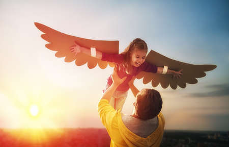 Photo pour Father and his daughter child playing together. Little girl plays in the bird. Happy loving family having fun. - image libre de droit