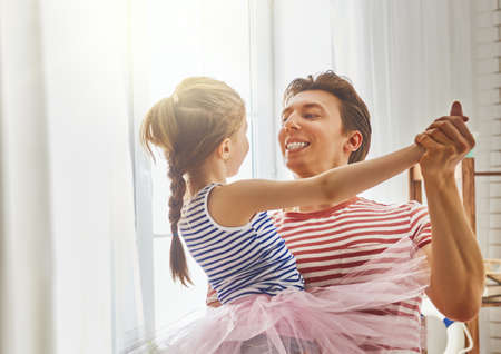 Photo for Happy father's day! Dad and his daughter child girl are playing, smiling and dancing. Family holiday and togetherness. - Royalty Free Image