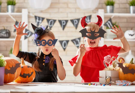 Photo for Cute little children girls with carving pumpkin. Happy family preparing for Halloween. Funny kids at home. - Royalty Free Image