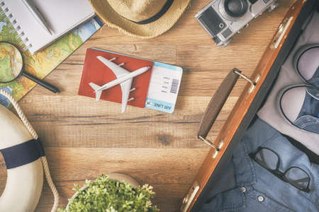 Photo for Go on an adventure! The map, suitcase, passports, tickets and the camera on a wooden table. Top view. - Royalty Free Image