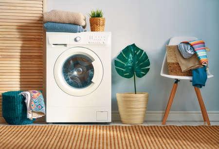 Foto de Interior of a real laundry room with a washing machine at home - Imagen libre de derechos