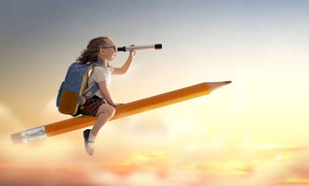 Photo for Back to school! Happy cute industrious child flying on the pencil on background of sunset sky. Concept of education and reading. The development of the imagination. - Royalty Free Image