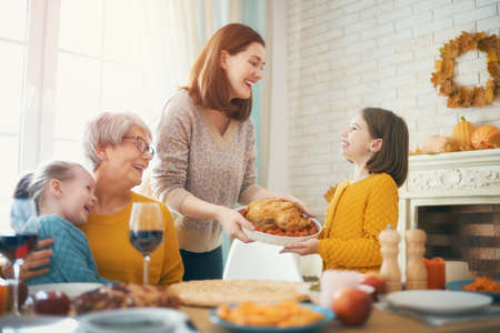 Photo for Happy Thanksgiving Day! Autumn feast. Family sitting at the table and celebrating holiday. Traditional dinner. Grandmother, mother and daughters. - Royalty Free Image