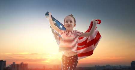 Photo for Patriotic holiday. Happy kid, cute little child girl with American flag. USA celebrate 4th of July. - Royalty Free Image
