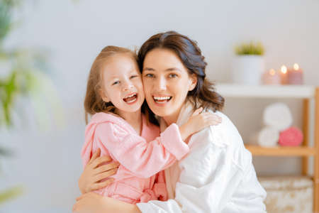 Photo pour Happy family! Mother and daughter child girl are caring for skin in the bathroom. - image libre de droit