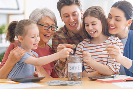 Photo pour Family are sitting at a desk with a paper receipt and calculating expenses, managing budget. - image libre de droit