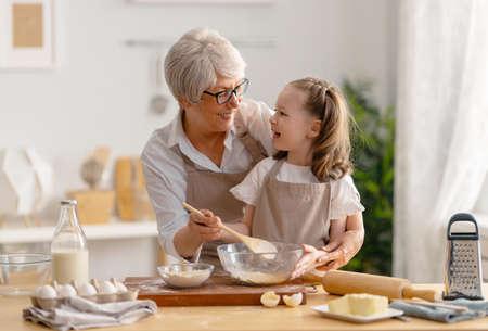 Photo pour Happy loving family are preparing bakery together. - image libre de droit