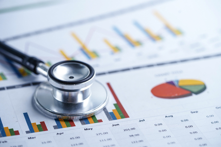 Photo pour Stethoscope, Charts and Graphs spreadsheet paper, Finance, Account, Statistics, Investment, Analytic research data economy spreadsheet and Business company concept. - image libre de droit