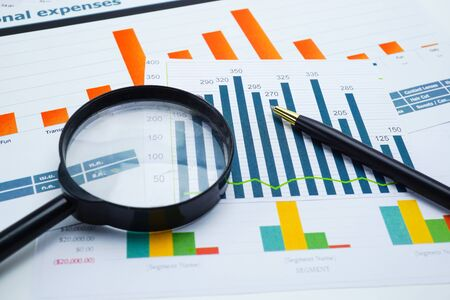 Photo for Magnifying glass on charts graphs spreadsheet paper. Financial development, Banking Account, Statistics, Investment Analytic research data economy, Stock exchange trading, Business office company meeting concept. - Royalty Free Image