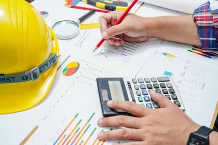 Photo pour Architect or engineer working project accounting with graph with tools in office, Construction account concept. - image libre de droit