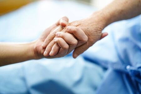 Photo for Holding Touching hands Asian senior or elderly old lady woman patient with love, care, helping, encourage and empathy at nursing hospital ward : healthy strong medical concept - Royalty Free Image