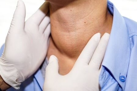Photo pour Asian lady woman patient have abnormal enlargement of thyroid gland Hyperthyroidism (overactive thyroid) at the throat : healthy strong medical concept   - image libre de droit