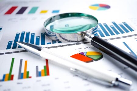 Photo pour Magnifying glass on charts graphs spreadsheet paper. Financial development, Banking Account, Statistics, Investment Analytic research data economy, Stock exchange trading, Business office company meeting concept.  - image libre de droit