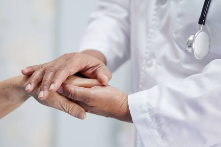 Photo pour Holding Touching hands Asian senior or elderly old lady woman patient with love, care, helping, encourage and empathy at nursing hospital ward : healthy strong medical concept   - image libre de droit