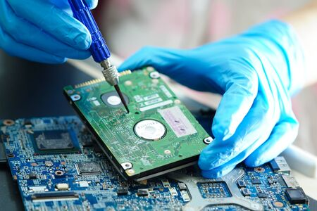 Photo pour Asian Technician repairing micro circuit main board computer electronic technology : hardware, mobile phone, upgrade, cleaning concept. - image libre de droit