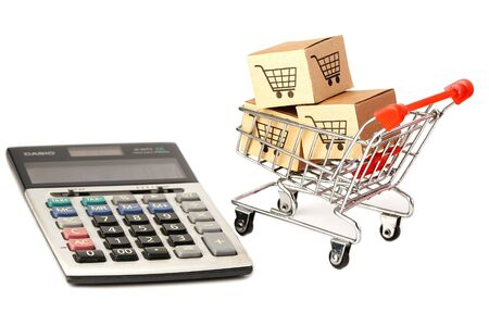 Foto de Shopping cart logo on box with calculator : Banking Account, Investment Analytic research data economy, trading, Business import export online company concept. - Imagen libre de derechos