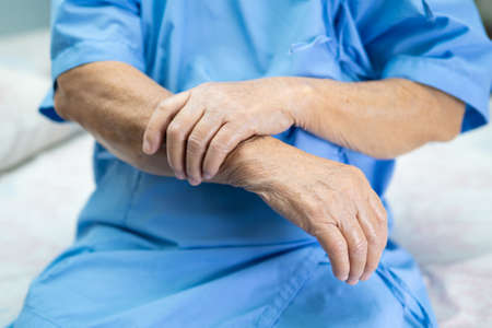 Photo for Asian senior or elderly old lady woman patient feel pain at arm and hand on bed in nursing hospital ward, healthy strong medical concept. - Royalty Free Image
