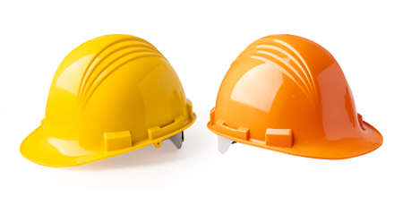 Photo pour Yellow and Orange color construction helmet isolated on white background, engineer safety concept. - image libre de droit