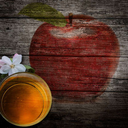 ripe red apple with green leaf isolated on wooden boards and apple blossom
