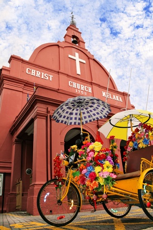Two icons of Malacca, Malaysia The trishaw  beca  and Christ Church
