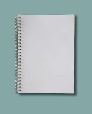 Photo for spiral-bound blank page notepad on blue background - Royalty Free Image