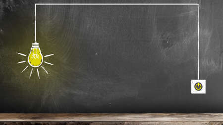 Photo for chalk drawing of glowing light bulb and switch on blackboard symbolizing an idea or innovation - Royalty Free Image