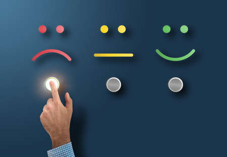 Photo for customer service rating and survey concept with dissatisfied customer touching interface button with sad face - Royalty Free Image