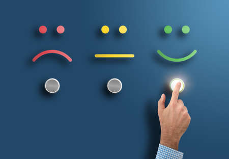 Photo for customer service rating and survey concept with hand touching interface button with smiling face - Royalty Free Image