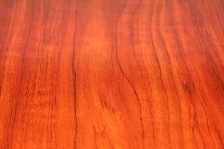 red wood finish on a slab, showing saturated reds and intricate graining