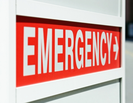 A red Emergency sign at the entrance to a hospital