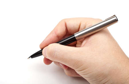 Hand holding a pen in the writing position.