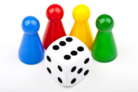 Board game Pieces and Dice over a plain white background