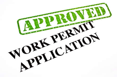 A close-up of an APPROVED Work Permit Application document