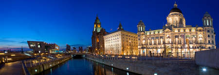 A twilight panoramic view of the Three Graces in Liverpool  The Royal Liver Building, Cunard Building and the Port of Liverpool Building