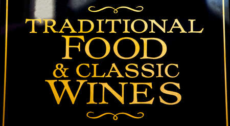 A pub sign advertising Traditional Food and Classic Wines.